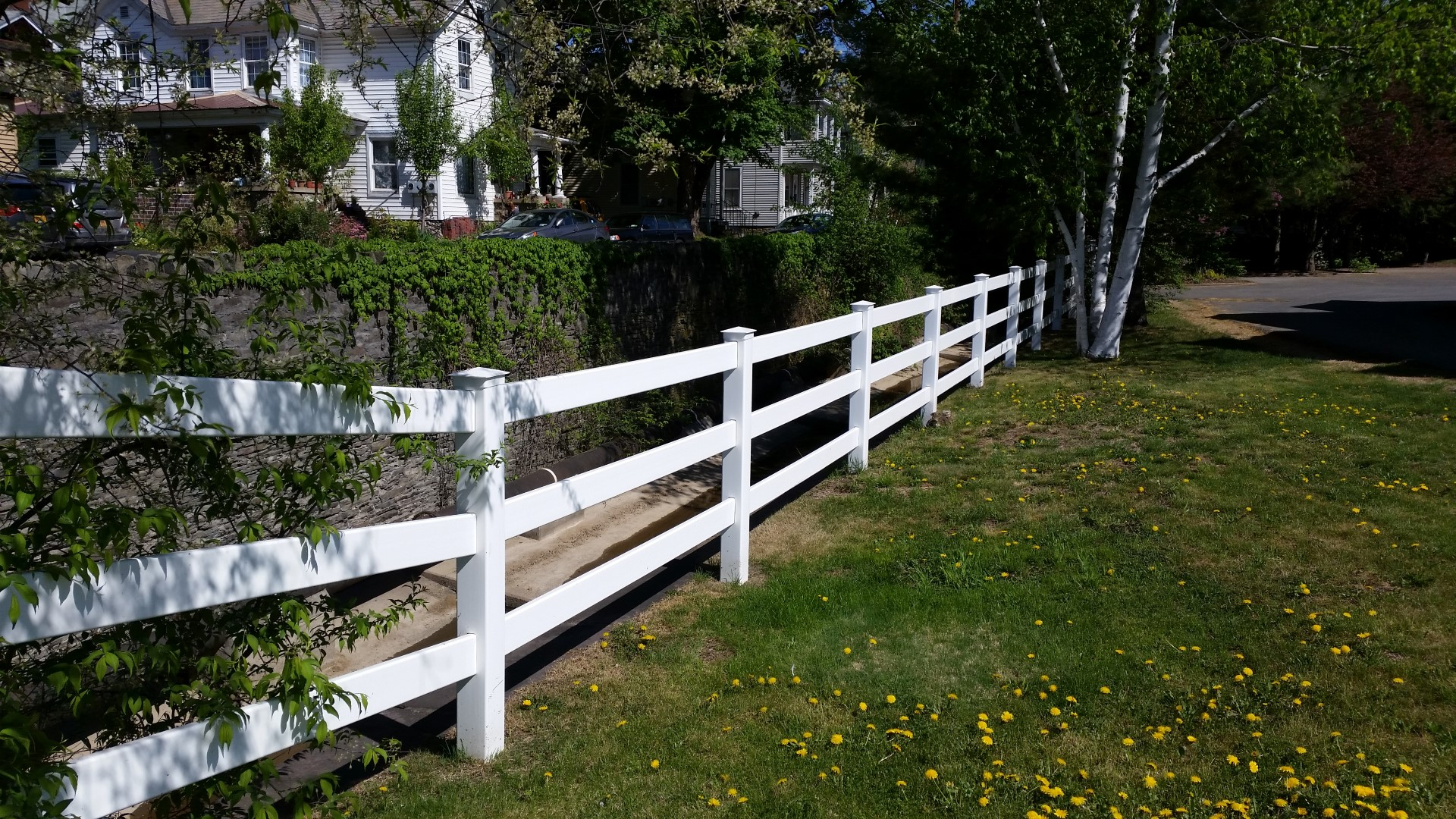 This is a 3 Rail Vinyl fence we installed in downtown Oneonta in 2013. It's on Main Street right across from the Post Office.