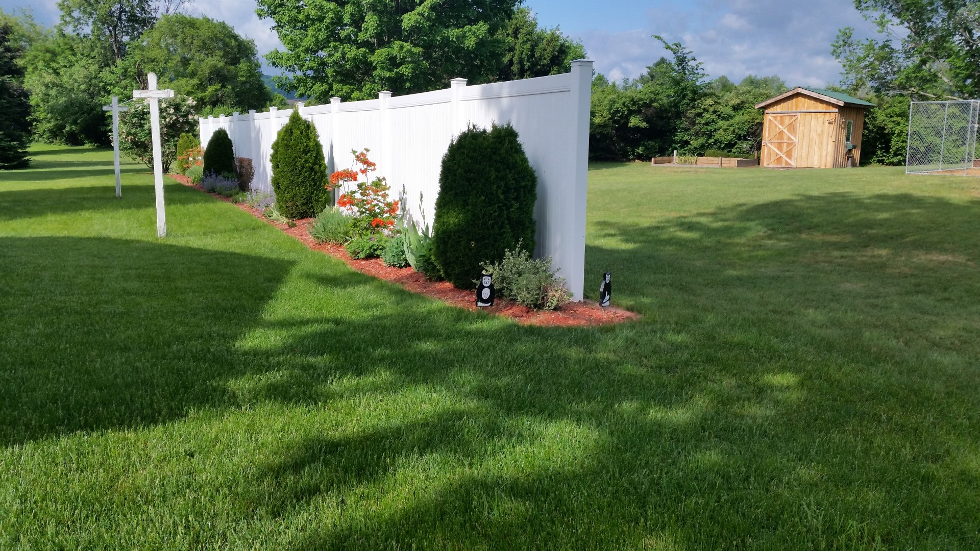 Oneonta 2011. We installed this 6' Vinyl fence to create some backyard privacy. See how the white background accents the plants and shrubs.