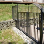 ONEONTA 2011  This 4' high Ornamental Aluminum fence meets NYS Pool Code requirements. The tricky part was dealing with the existing stone wall.