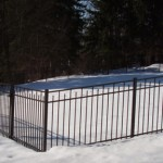 "This is a 48"" Jerith ""200"" we installed in 2009 in Fly Creek. As you can see, aluminum fences can work very well on slopes."