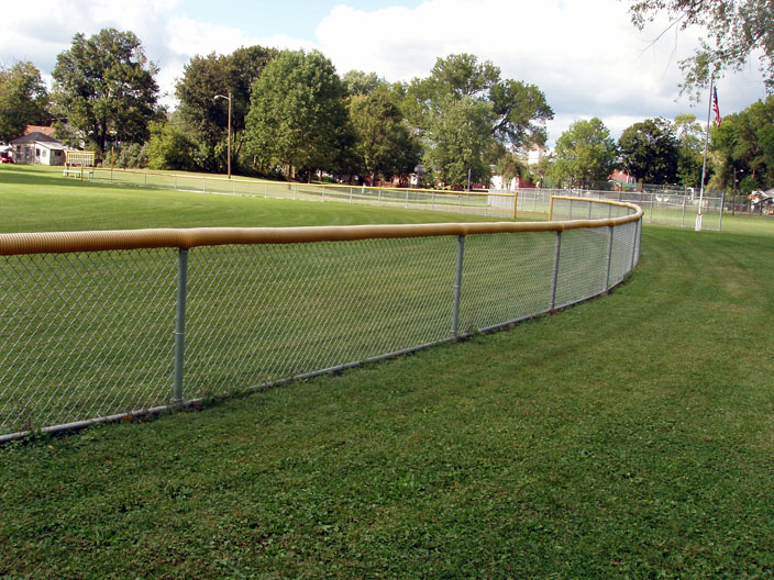 In 2006, we replaced over 1000' of old, bent, rusted 3', 4' and 6' high chain link fence on the baseball fields at the Village Park in Milford. Note the nice curve in the outfield fences.