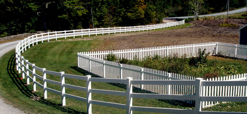That is a post and rail fence along the driveway and a picket fence around the garden. This project we installed near Gilboa in 2006, is a great example of how a fence can complement and accent the curves and contours of your terrain.