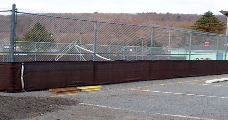 We restored this 10' high fence at the Bainbridge Pool in 2009. We also installed the windscreen to keep debris from blowing into the pool.