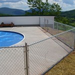 ROXBURY 2012 Pool enclosures don't have to be fancy or expensive. This 4' high galvanized chain link fence does the job and meets code too.