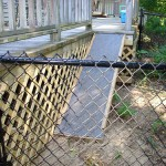 This one was a challenge – How to get Rover off the deck into a fenced enclosure. Simple! The fence is a 4' high black vinyl chain link. We remove some deck railing, built a ramp complete with no-slip outdoor carpeting and added some lattice work.