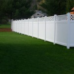 This is a 6' high vinyl privacy fence with a lattice accent. Vinyl fences offer two great features. There is no maintenance ever and there is no front or back – they look the same from both sides.