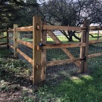 We installed this dog containment fence in Norwich in 2019. The top rail finished at 4' above grade. The wire prevents the dogs from escaping between the rails.
